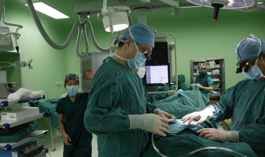 Doctors prepare for surgery.