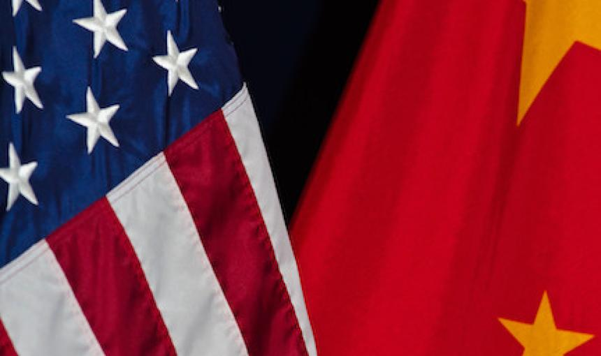 A photo depicts the U.S. flag next to the China flag.