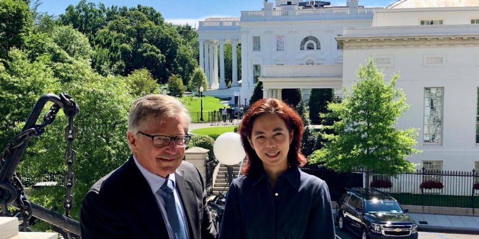 Fei-Fei Li and John Etchemendy in front of the White House