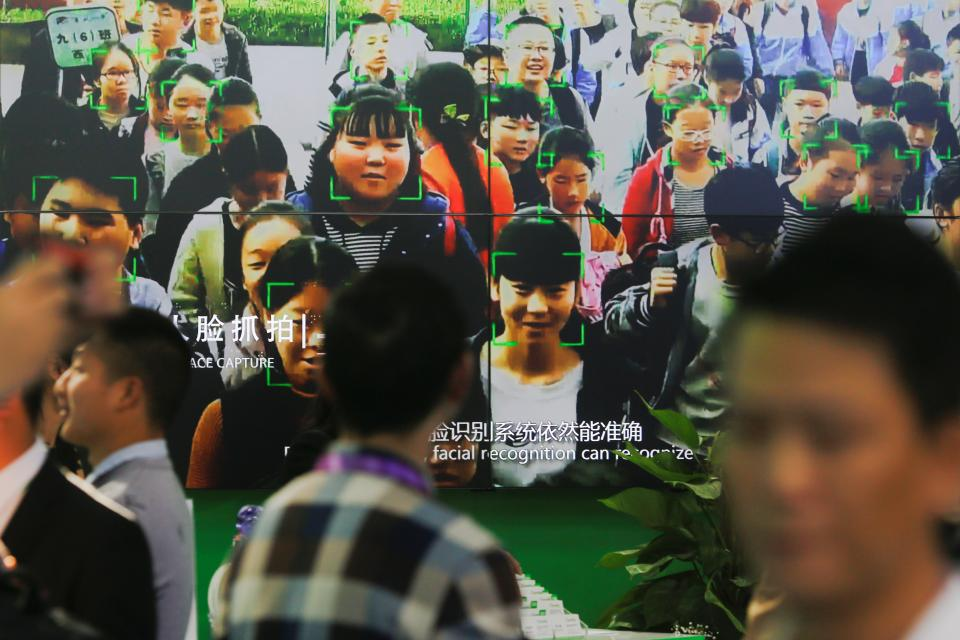 Security forces use facial recognition software at a conference in Beijing.