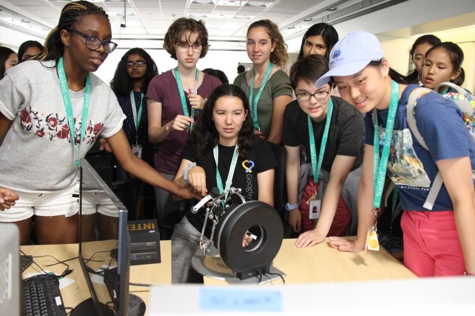 Young women work on a project during Stanford's AI4ALL summer program.